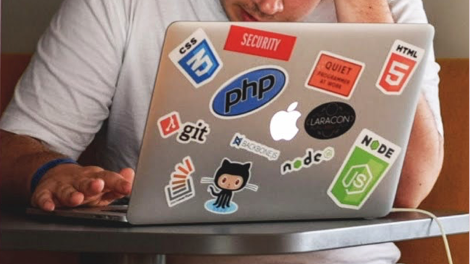 laptop with open-source stickers